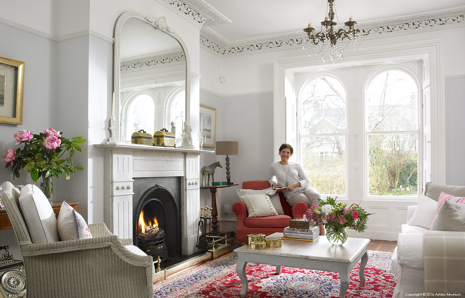Emma Cooper in the sitting room of her Victorian semi detached house in Belfast.